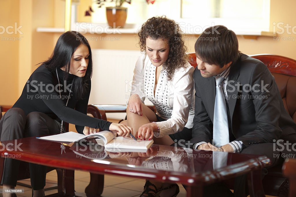 Young Couple Signing Contract royalty-free stock photo