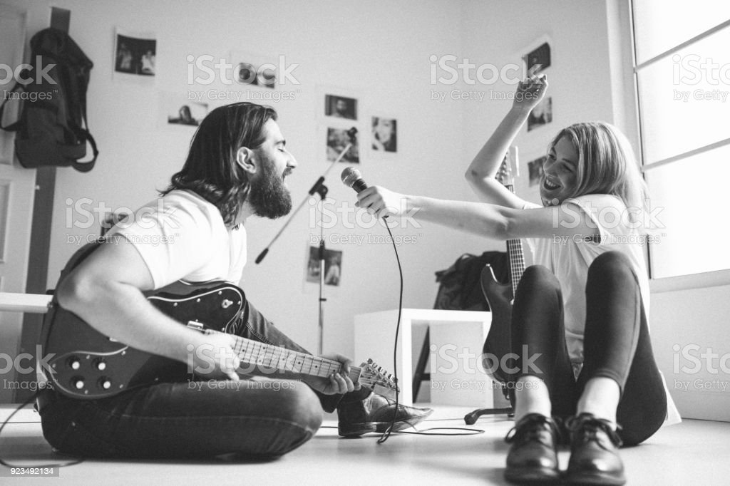 Young Couple Singing In Music Studio Royalty Free Stock Photo