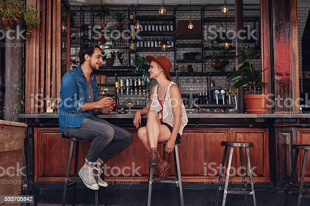Young couple sitting at cafe counter picture id533705842?b=1&k=6&m=533705842&s=612x612&h=s8xxnj3vz8cgzsrce 9xoza8fyozwgamvy  ewojpf4=