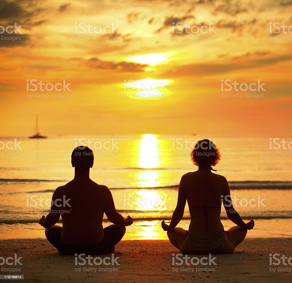Young couple sitting on beach of the sea royalty-free stock photo