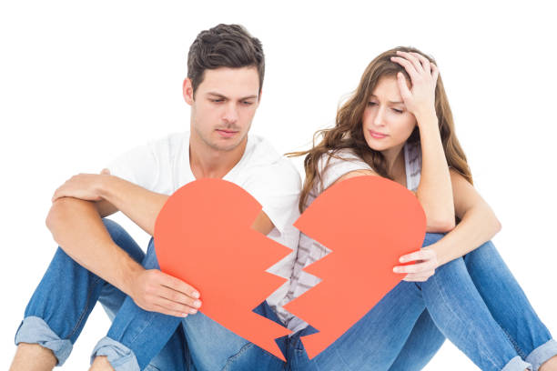 young couple sitting on floor with broken heart - separation stock photos and pictures