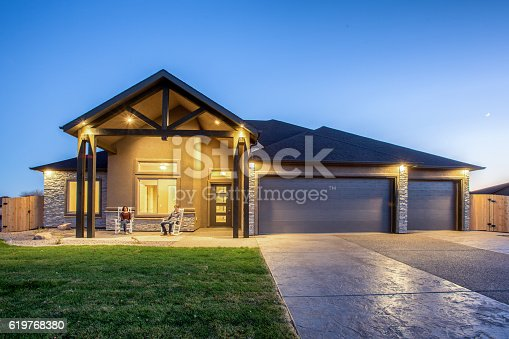 istock Young Couple Sitting on Porch of New Home at Twilight 619768380