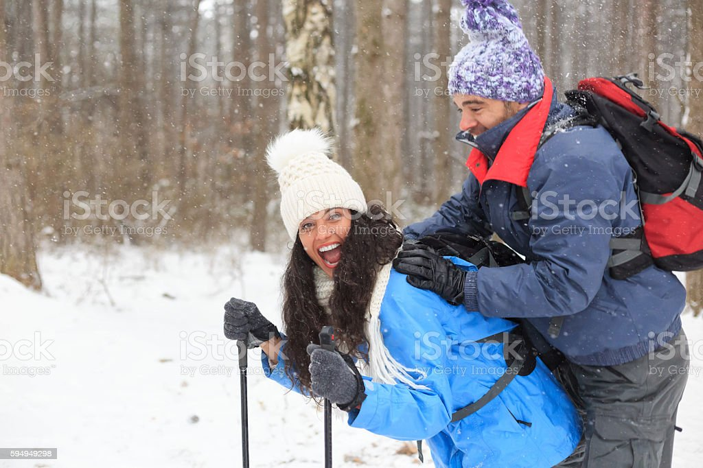 Young couple skiers having fun in snow forest stock photo