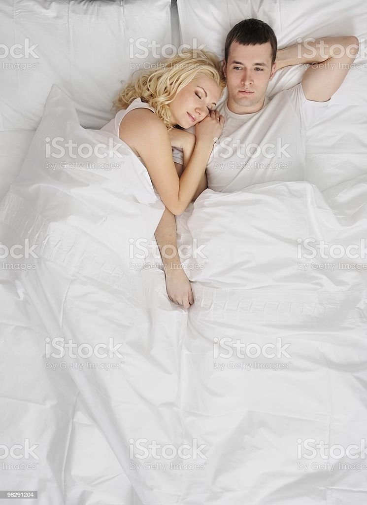 Young couple sleeping in a bed royalty-free stock photo