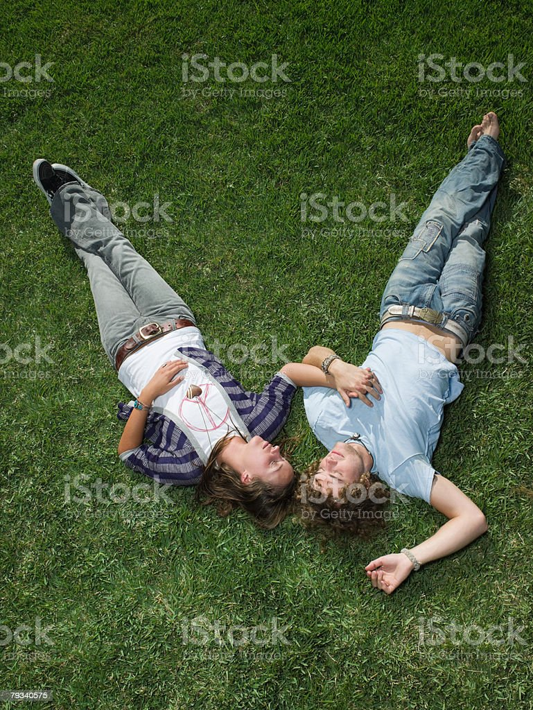 Young couple sleeping in a field 免版稅 stock photo