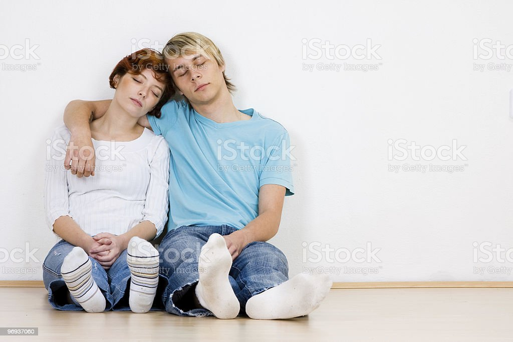 Young couple sleeping indoors royalty-free stock photo