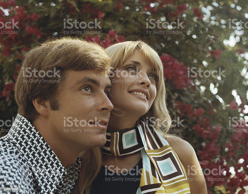 Young couple smiling and looking away stock photo