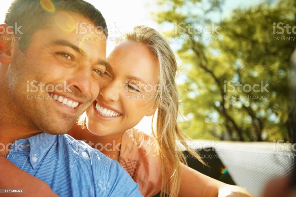 Young couple smiling in the sun royalty-free stock photo