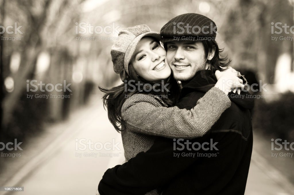 Young Couple Smiling Outdoors, Black and White royalty-free stock photo