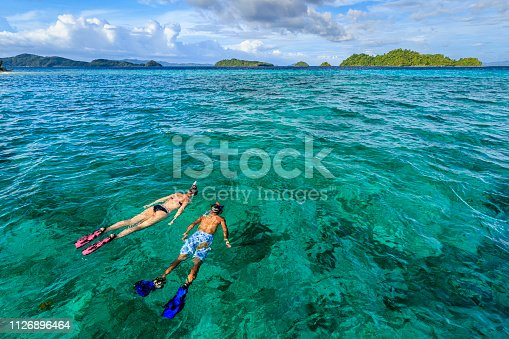 istock Young couple snorkeling on East China Sea, Philippines 1126896464