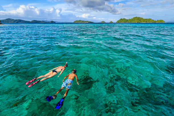 Young couple snorkeling on East China Sea, Philippines stock photo