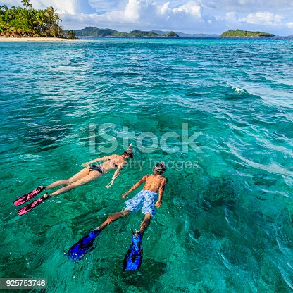 istock Young couple snorkeling on East China Sea, Philippines 925753746
