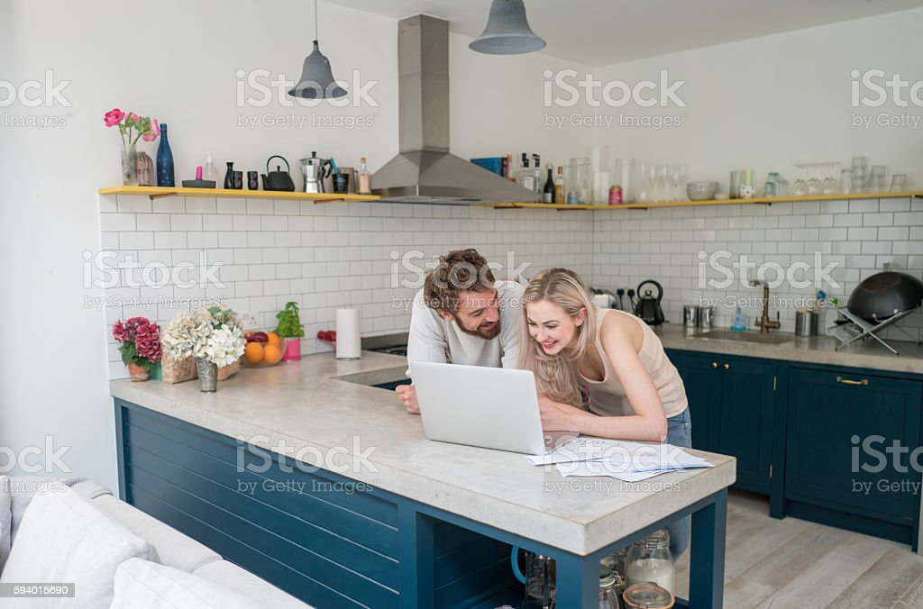 Young couple social networking at home stock photo