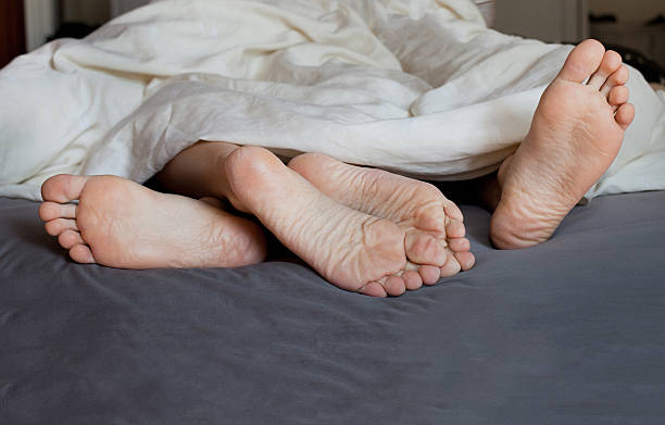 A young couple spending the day in bed family, couple in the bed real couples making love stock pictures, royalty-free photos & images