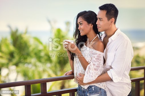 1065243116 istock photo Young couple spending time on terrace 689984142