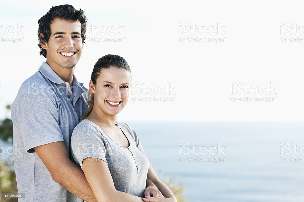 Young Couple Standing Affectionately royalty-free stock photo