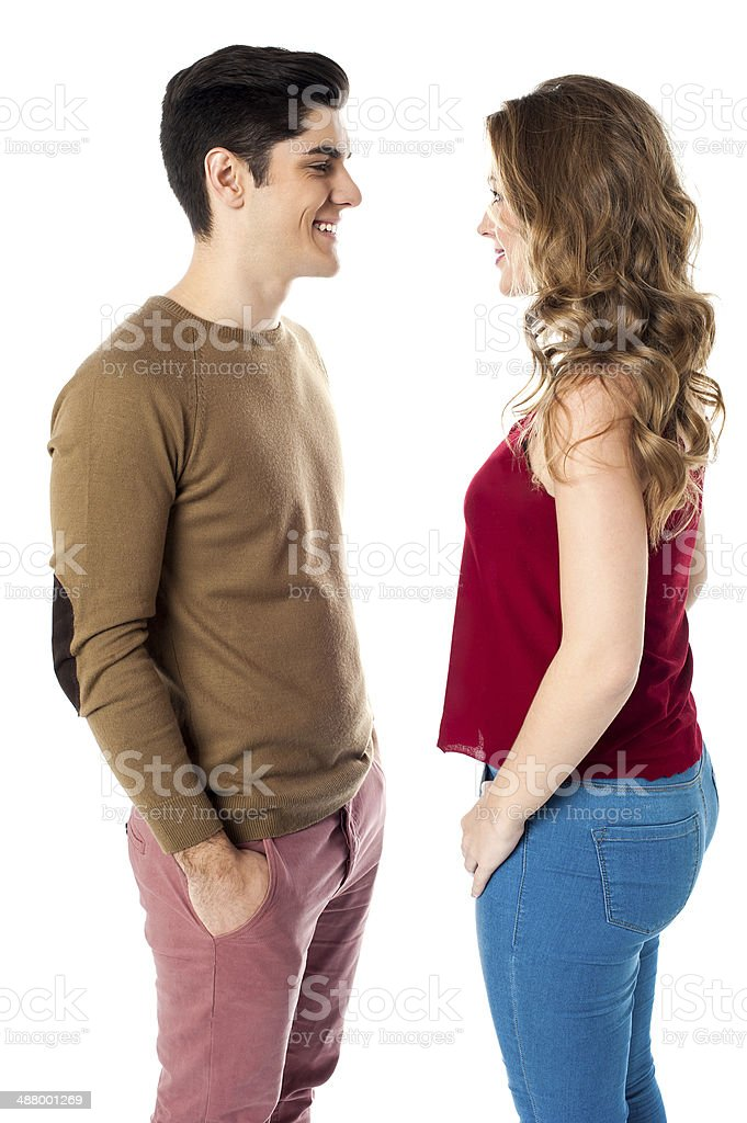 Young couple standing face to face stock photo