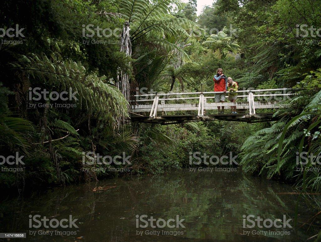 Young couple standing on bridge royalty-free stock photo