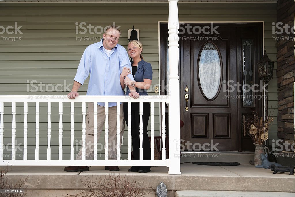 Young Couple Standing on Porch royalty-free stock photo