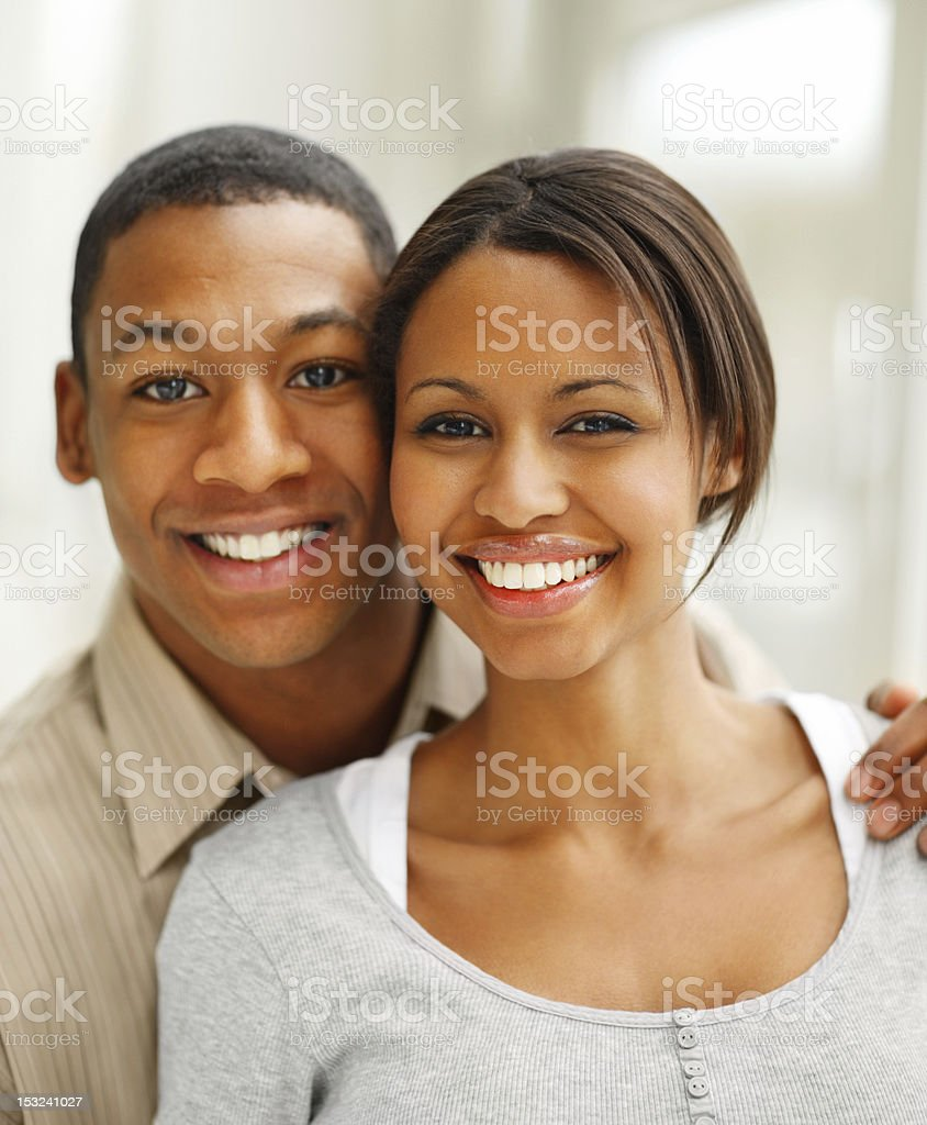 Young couple standing together and smiling royalty-free stock photo