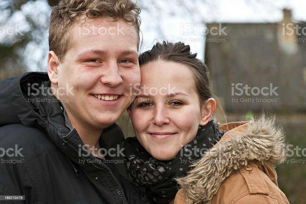 Young couple standing together outside royalty-free stock photo