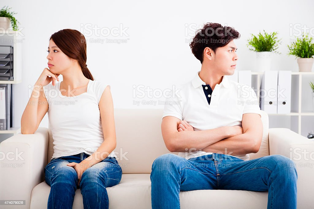 young Couple stress and  sitting on the sofa stock photo