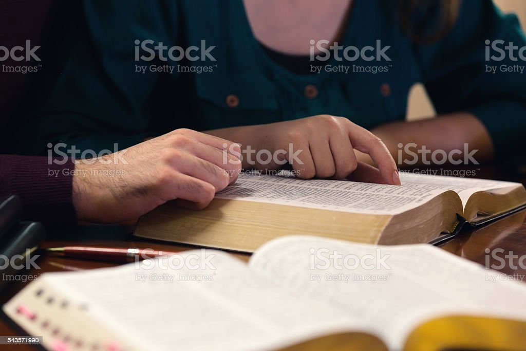 Young Couple Studying The Bible stock photo