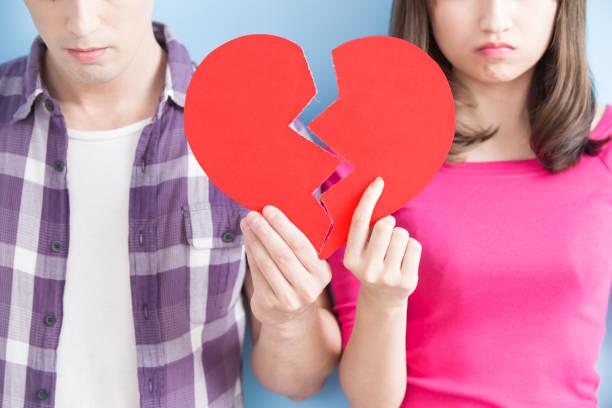 young couple take broken heart stock photo