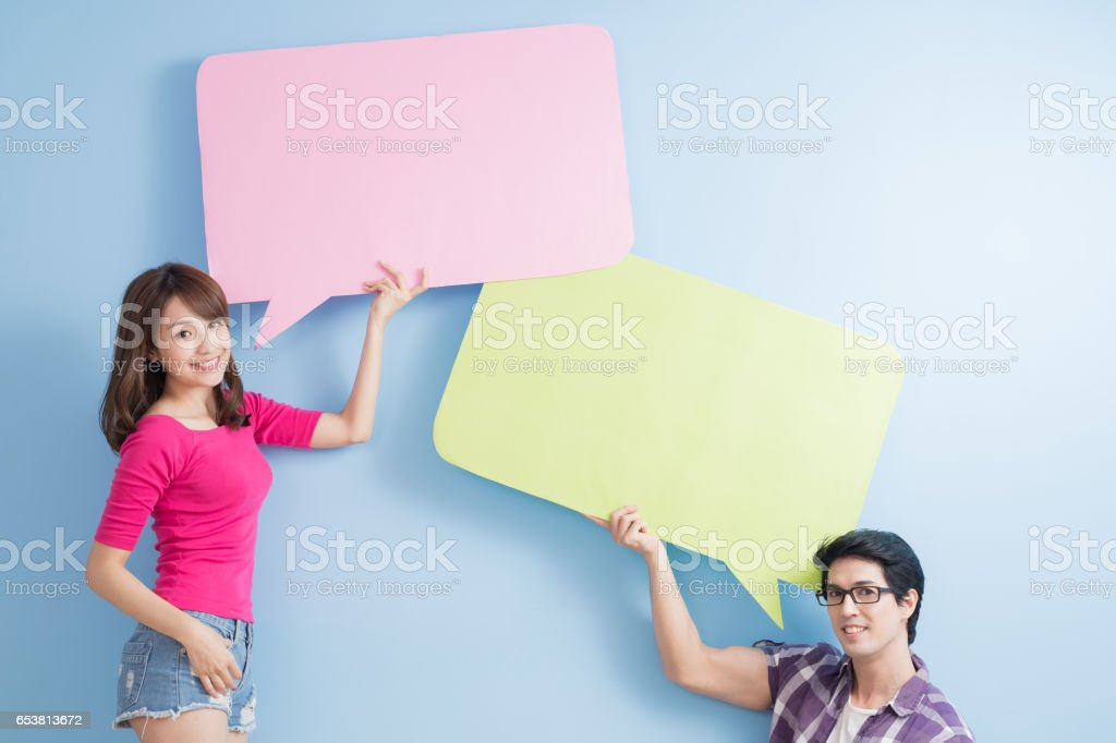 young couple take speech bubble stock photo