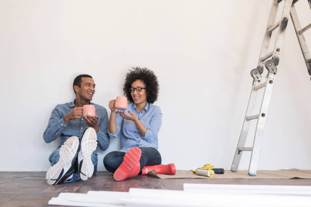 Young couple taking a break from DIY stock photo
