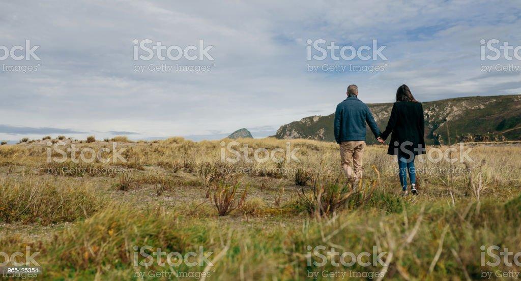 Young couple taking a walk near the coast zbiór zdjęć royalty-free