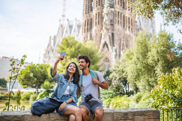 Young Couple Taking Break from Sightseeing for Selfie stock photo