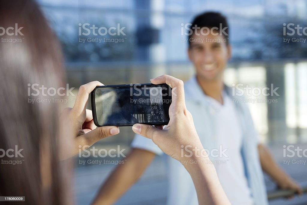 Young couple taking photos with mobile royalty-free stock photo