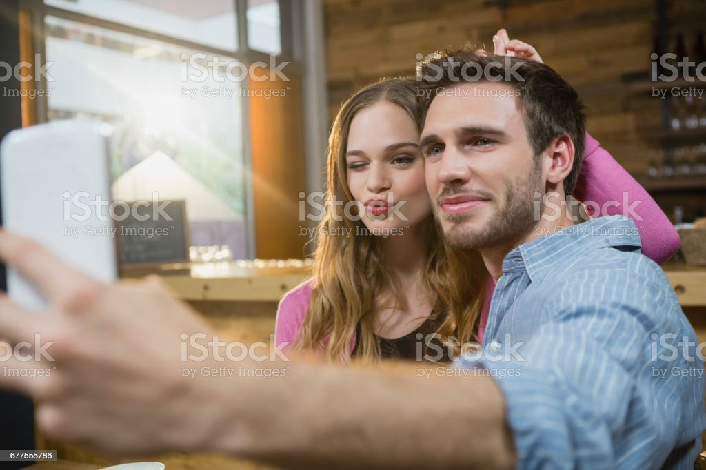 Young couple taking selfie on mobile phone stock photo