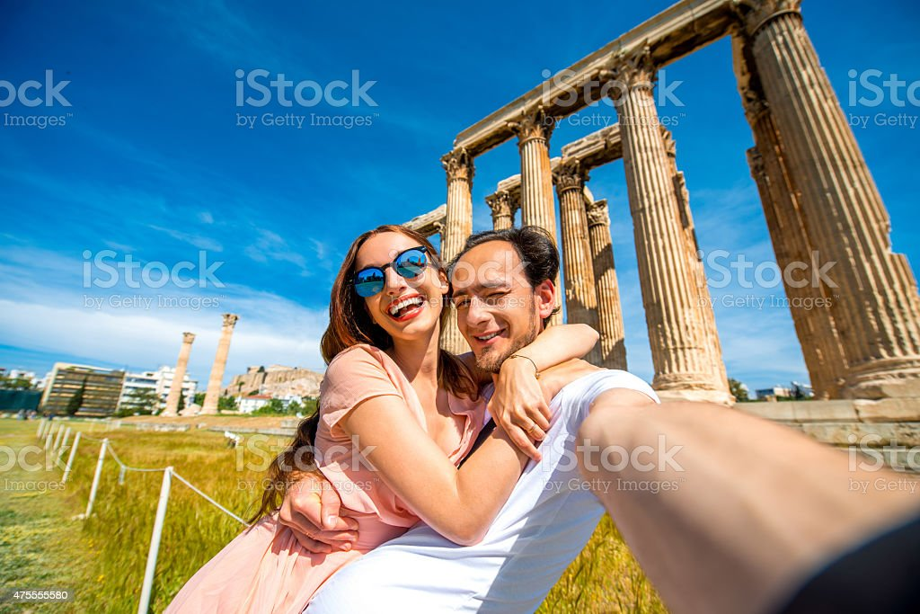 Young couple taking selfie picture with Zeus temple on background stock photo