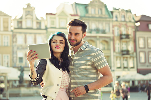 Young Couple Taking Selfie Using A Digital Tablet Stock Photo - Download Image Now