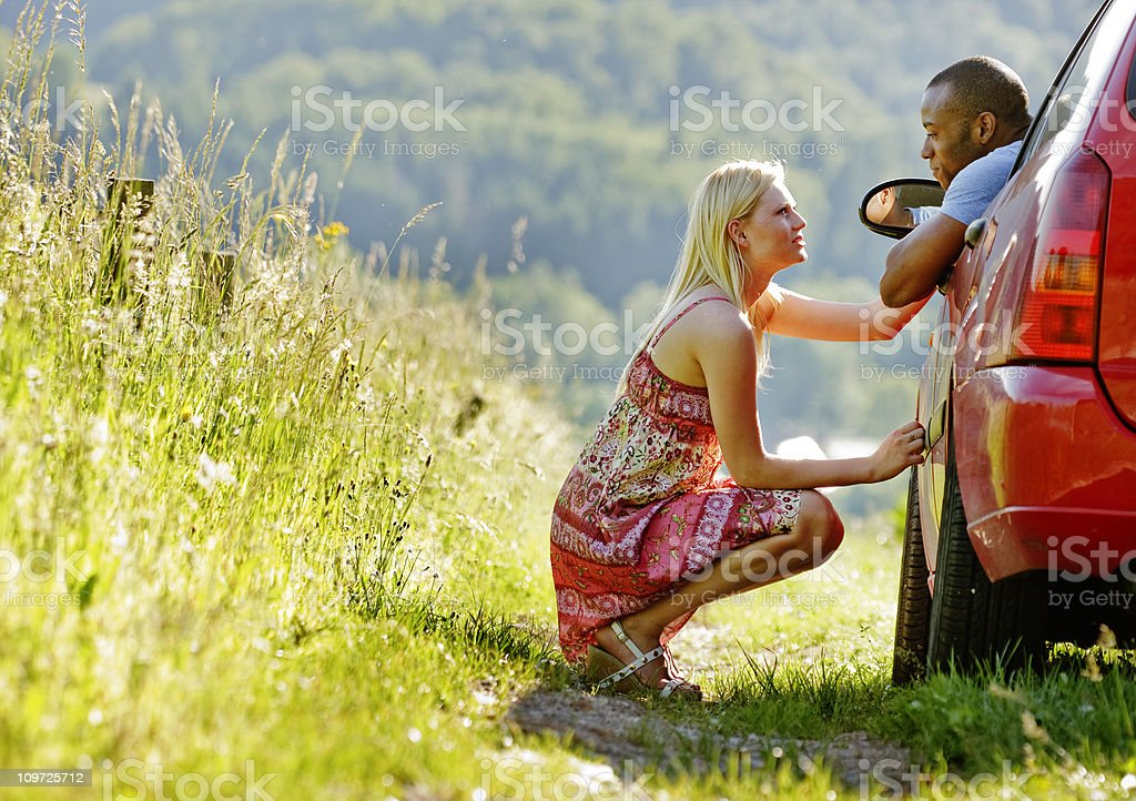 Young Couple Talking on a Country Hillside royalty-free stock photo