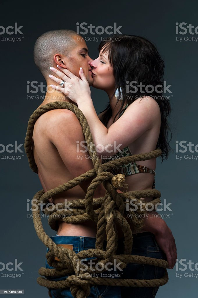 young couple tangled up. stock photo