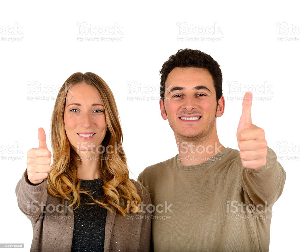 Young couple thumbs up stock photo