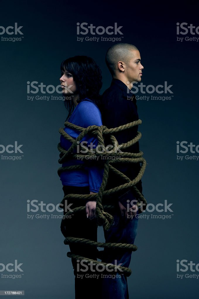 young couple tied up with hawser stock photo