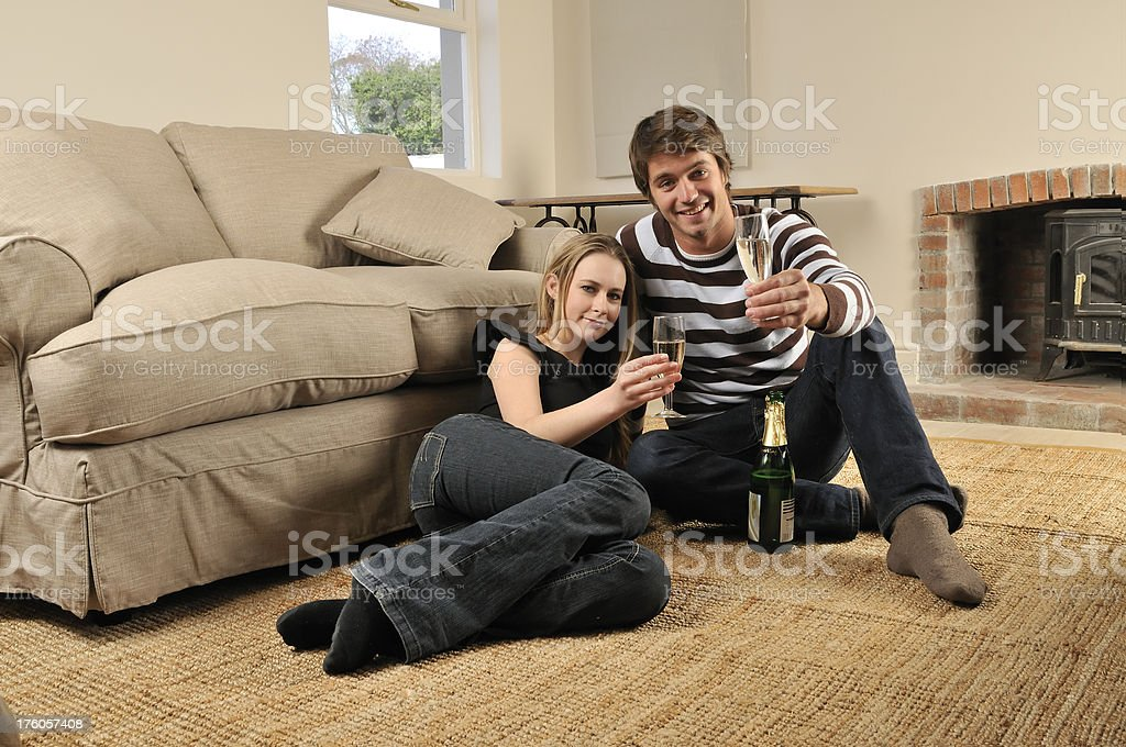 Young couple toasting new home royalty-free stock photo