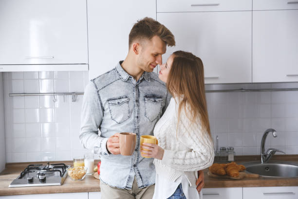 Young couple together at home love concept drinking coffee picture id1194573658?b=1&k=6&m=1194573658&s=612x612&w=0&h= m0nzpzcrgmskamsudospyuus9kphsca8emd4lntfeo=