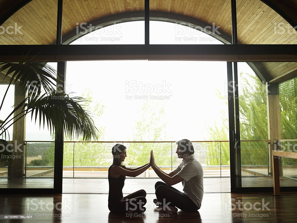 Young couple touching hands, side view 免版稅 stock photo