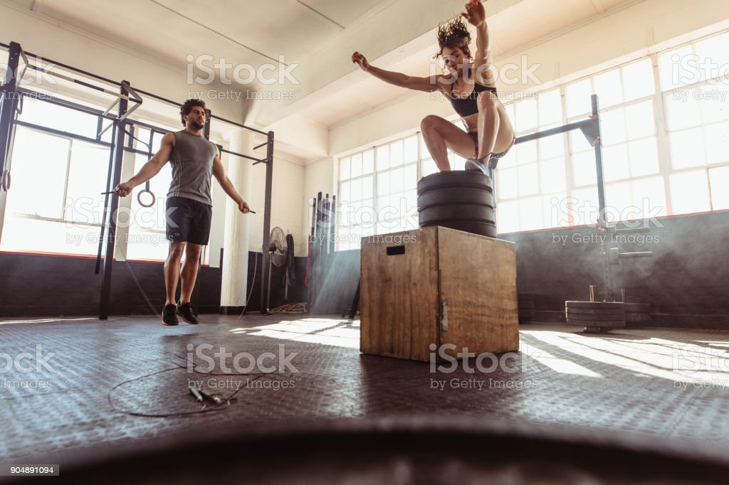 Young couple training hard at the gym stock photo