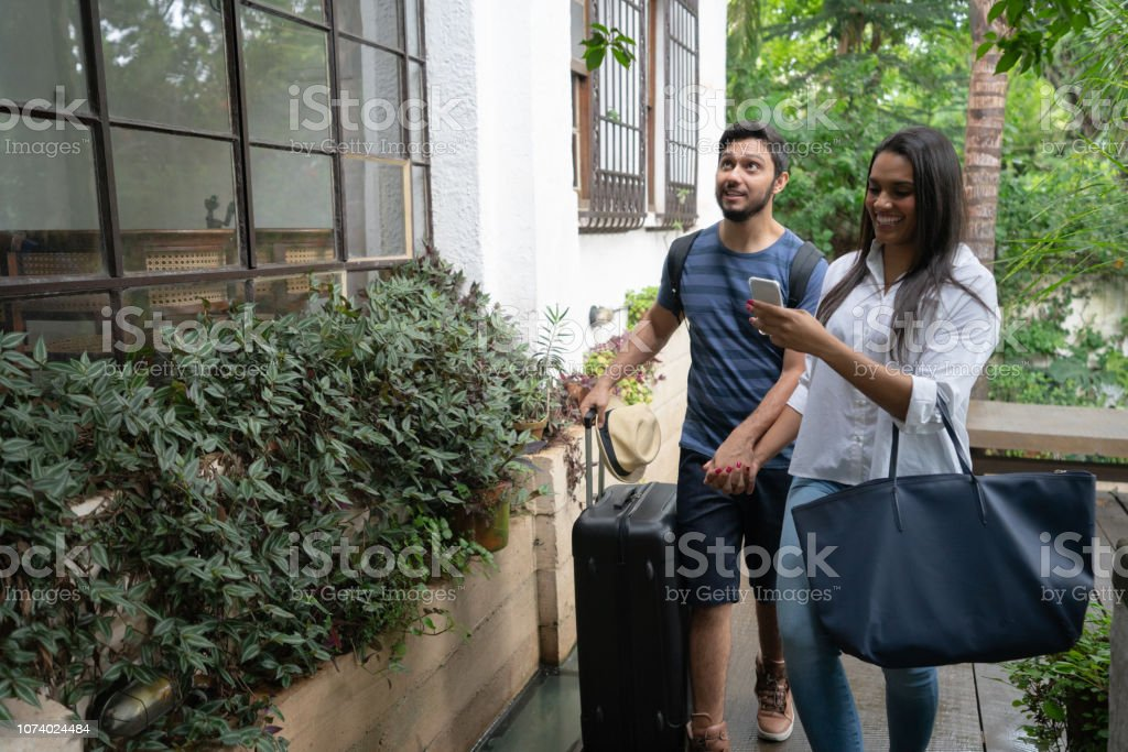 Young Couple Traveler Arrival at Accommodation - Bed and Breakfast or Hostel / Hotel Travel Destinations Adults Only Stock Photo
