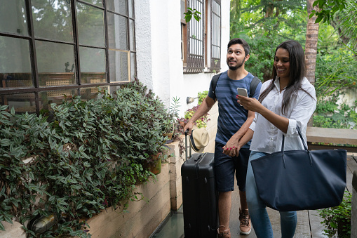 Young Couple Traveler Arrival At Accommodation Bed And Breakfast Or Hostel Hotel Stock Photo - Download Image Now