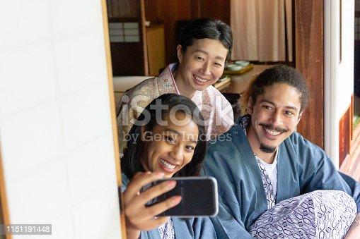 Young couple taking selfie with Okami, the landlady of ryokan