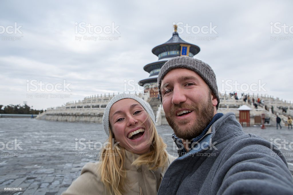 Young couple traveling take selfie with Temple of Heaven,Beijing stock photo