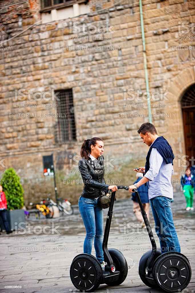 Young Couple Travelling with Segway, Florence, Italy royalty-free stock photo