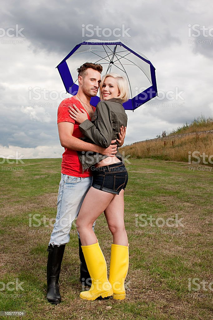 Young couple under umbrella royalty-free stock photo